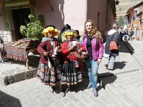 Local women with tourists at the Sacred Valle of the Incas